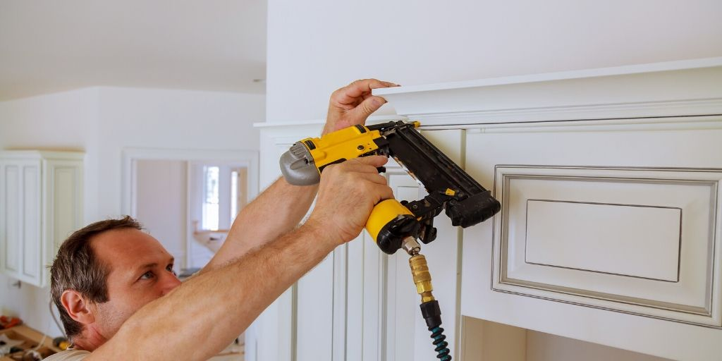 finishing nailer being used to put on crown molding