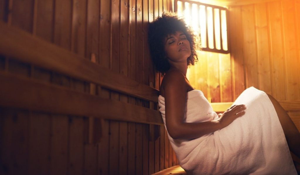 woman relaxing at her sauna room