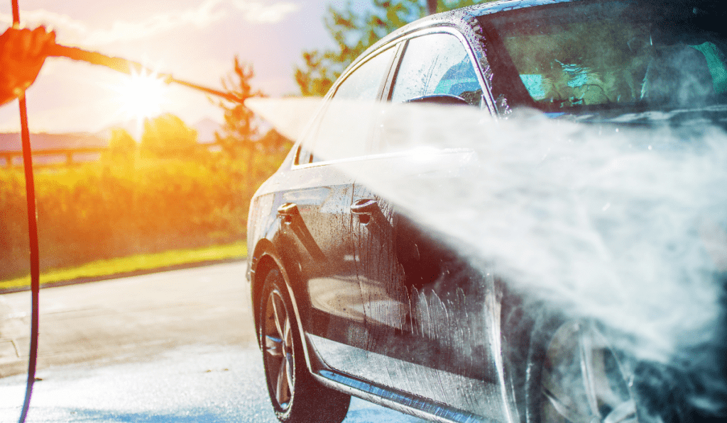 cleaning car using pressure washer