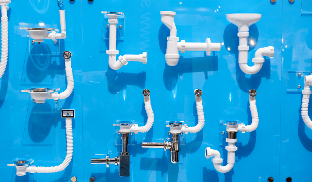 Different kind of pipe pinned on the blue wall