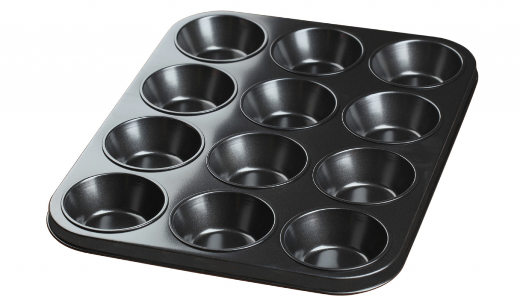 A muffin tin on a white background.