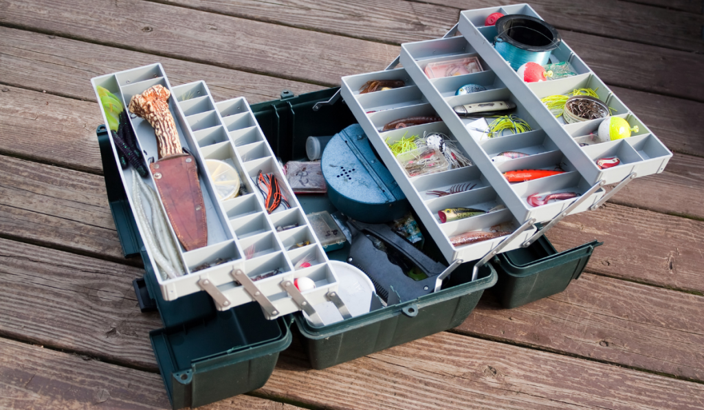 A tackle box with fishing tools inside it.